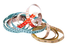 Three Tape Measures Marked in Inches and Centimetres Royalty Free Stock Photo