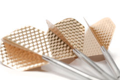 Three target playing darts, whit golden color feather,  Royalty Free Stock Images