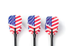 Three target playing darts, whit USA flag colors in the feather Stock Images
