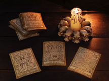 Three tarot cards with evil candle. The tarot cards with candle. The High Priestess, the Devil and Judgement. Halloween and magic still life, fortune telling Royalty Free Stock Photos