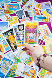 Three Tarot Cards Held In Hand. Royalty Free Stock Image