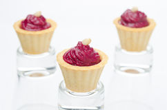 Three tartlets with beetroot mousse with goat cheese horizontal Stock Images