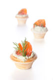 Three tarts with salmon and cheese Royalty Free Stock Photography
