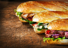 Three tasty baguettes with savory fillings Royalty Free Stock Photo