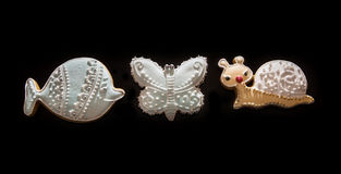 Three tasty gingerbread cookies, fish, butterfly and snail Stock Images