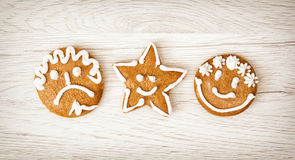 Three tasty gingerbread smiley faces, Christmas symbol Royalty Free Stock Photos