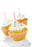 Three tasty muffins with candle Royalty Free Stock Photo