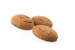 Three tasty oatmeal cookies. Isolated over white background royalty free stock photo
