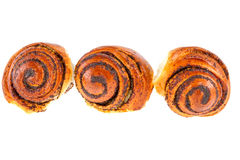 Three tasty rolls buns with poppy seeds on a white background Stock Images