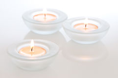 Three tealights with reflections Stock Images