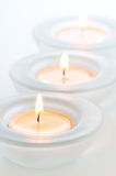 Three tealights with reflections Stock Image