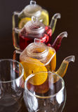 Three teapots with different fruit tastes of tea Stock Image