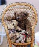Three Teddy Bears on Chair Stock Photos