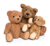 Three teddy bears isolated on white - concept for happy family. Stock Image