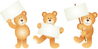 Three teddy bears with signboards Royalty Free Stock Image