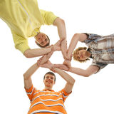 Three teen boys holding in a form of a star Royalty Free Stock Images