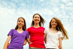 Three teen cheerful girls Stock Image