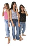 Three Teen Girls With Cellphones Over White Stock Images