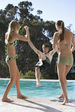 Three teenage friends by the pool Royalty Free Stock Photos