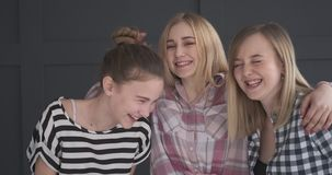 Three teen girl friends laughing stock video