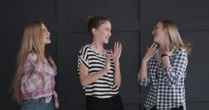 Teenage girls dancing against studio background stock video