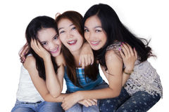 Three teenage girls friends smiling Royalty Free Stock Photos
