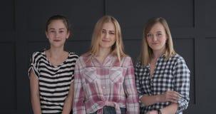 Teenage girls gesturing and shaking head in denial stock video footage