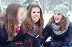 Three teenage girls having fun in the snow Stock Photos