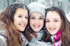Three teenage girls having fun in the snow Stock Images