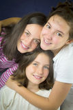 Three teenage girls hugging Stock Images
