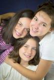 Three teenage girls hugging Stock Images