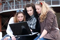 Three teenage girls with laptop Royalty Free Stock Photos