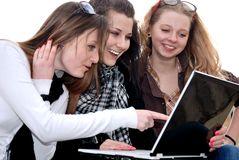 Three teenage girls with laptop Stock Images