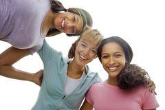 Three teenage girls smiling, portrait, low angle view, cut out Royalty Free Stock Photos