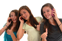Three teenage girls smiling together cell phones Royalty Free Stock Image