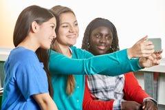 Three teenage girls taking a selfie. At school Royalty Free Stock Photo