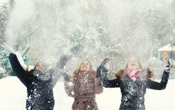 Three teenage girls throwing snow Royalty Free Stock Photo