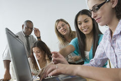 Three teenage girls using laptop. Stock Photo