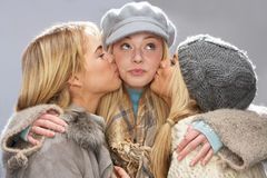 Three Teenage Girls Wearing Knitwear In Studio Stock Image