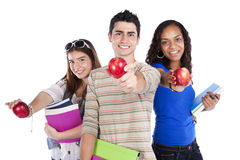 Three teenage studens. Three happy students holding books (isolated on white Royalty Free Stock Photo
