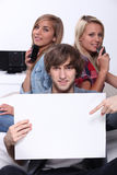 Three teenagers Stock Images