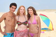 Three teenagers at the beach Stock Image