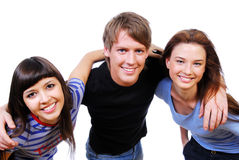 Three teenagers holding heads Royalty Free Stock Images