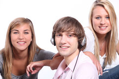 Three teenagers relaxing together Royalty Free Stock Photography