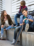 Three teenagers with smartphones in outdoors Stock Photography