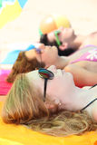 Three teenagers sunbathing Stock Image