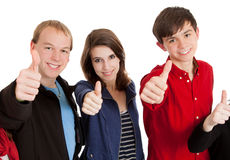 Three teenagers with their thumbs up. Three teenagers on a white background with their thumbs up Royalty Free Stock Photography