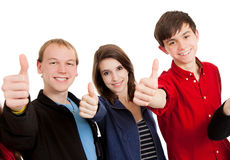Three teenagers on white with thumbsup Stock Photos