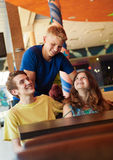 Three teens friends in cafe Stock Images