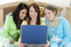 Three Teens and a Laptop Stock Photography